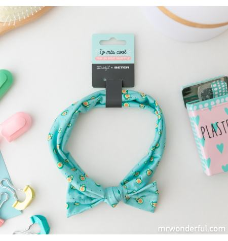 Elastic headband with a bow and avocado pattern